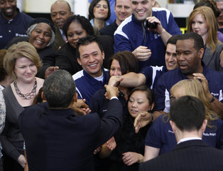 U.S. President Obama shakes hands after he speaks about the economy at the Rolls-Royce Crosspointe facility in Virginia