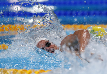 Agnel of France competes in the men's 200m freestyle heats during the World Swimming Championships in Barcelona