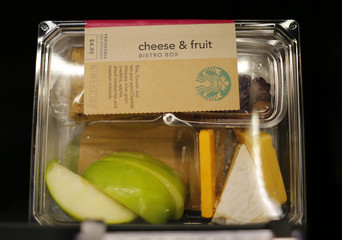 A cheese and fruit bistro box is shown for sale inside a newly designed Starbucks coffee shop in Fountain Valley, California