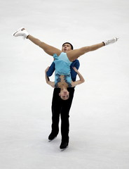Yu Xiaoyu and Jin Yang of China compete at the pairs free skating program during China ISU Grand Prix of Figure Skating, in Beijing