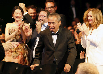 """Director Hou Hsiao-Hsien, Best Director award winner for his film """"The Assassin"""", reacts during the closing ceremony of the 68th Cannes Film Festival in Cannes"""