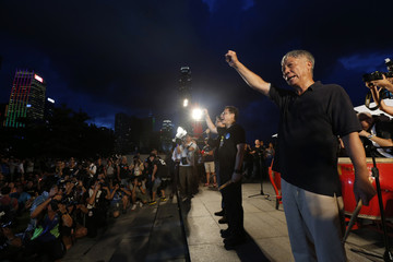 Founders of the Occupy Central civil disobedience movement Reverend Chu, academics Tai and Chan chant slogans during a campaign to kick off the movement in front of the financial Central district in Hong Kong