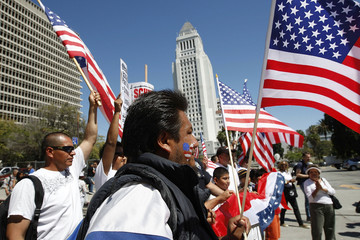 Protesters march near City Hall during a May Day immigration rally in Los Angeles, California.