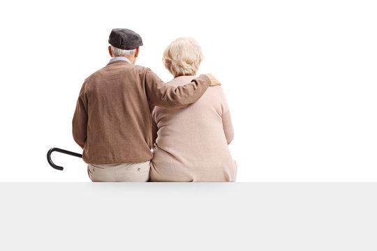 Rear view shot of senior couple sitting on panel