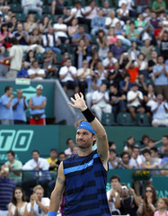 Moya of Spain waves to the crowd during his farewell exhibition tennis match against Canas of Argentina in Buenos Aires