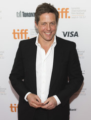 """Grant arrives on the red carpet for the gala presentation of the film """"Cloud Atlas"""" during the Toronto International Film Festival"""