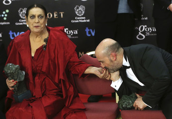 Actor Camara kisses the hand of actress Pavez during a family photo at the Spanish Film Academy's Goya Awards ceremony in Madrid