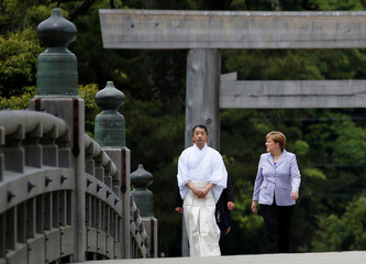 German Chancellor Angela Merkel walks on Ujibashi bridge as she visits Ise Grand Shrine in Ise, Mie prefecture, Japan ahead of the first session of  the G7 summit meetings.