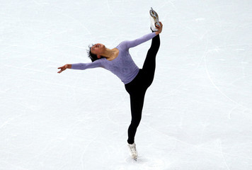 Asada of Japan skates during a figure skating training session at the Iceberg Skating Palace in preparation for the 2014 Sochi Winter Olympics