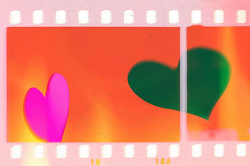 Vintage red and pink film strip frame with two hearts. Love concept.