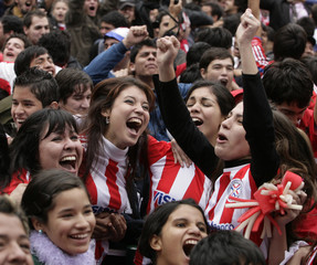 Paraguayan soccer fans celebrate Paraguay's victory over Japan in Asuncion