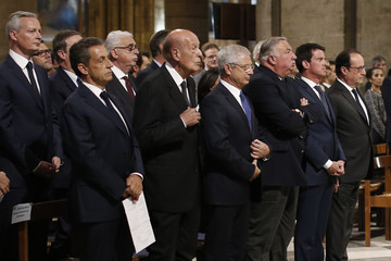 French President Francois Hollande and French politicians attend a mass to pay tribute to French priest Father Jacques Hamel at the Notre-Dame Cathedral in Paris