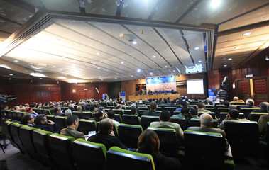 Businessmen and officials attend the International Conference for Benghazi Economic Capital - Reality and Ambition in Benghazi