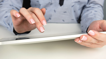 Woman using a touch screen tablet hands