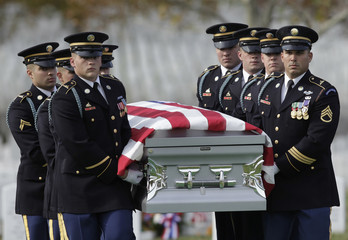 Honor guard carries the casket of seven US soldiers killed in Afghanistan before a funeral ceremony in Virginia