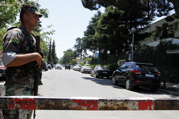 An officer of the Albanian army special forces guards the entrance of a road leading to foreign embassies, ahead of Sunday's general elections in Tirana