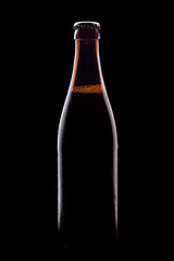 brown bottle of beer, clipping path,on a black background, with brilliant edges and foam
