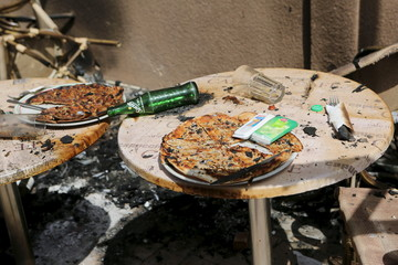 Pizzas are seen on the terrace of Cappuccino restaurant after an attack on the restaurant and the Splendid Hotel in Ouagadougou