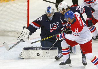 Goaltender Hellebuyck of the U.S. and Redmond defend a shot of Plekanec of the Czech Republic during their Ice Hockey World Championship third-place game at the O2 arena in Prague