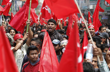 Maoist activists and supporters take part in a rally in Kathmandu