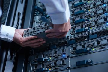 Blade server being held by an experienced engineer