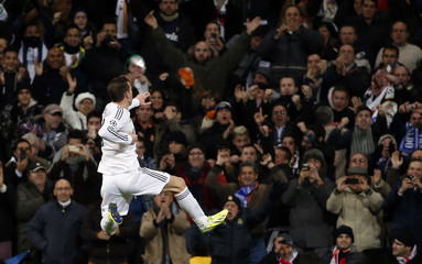 Real Madrid's Bale celebrates after scoring a goal against Galatasaray during their Champions League soccer match in Madrid