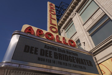 American jazz singer Dee Dee Bridgewater is advertised as an act at the Apollo Theater in Harlem, New York