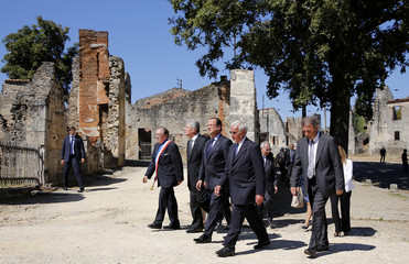 French President Hollande German President Gauck and massacre survivor Hebras walk in the streets of the French martyr village of Oradour-sur-Glane