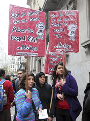 Pro-abortion activists hold placards outside the Buenos Aires' Legislative Palace