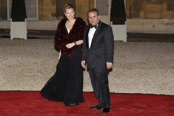 France's UMP leader Xavier Bertrand and his wife arrive at the Elysee Palace to attend a state dinner in Paris