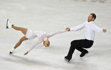 Caitlin Yankowskas skates with her partner John Coughlin during the pairs free skate program at the U.S. Figure Skating Championships in Greensboro