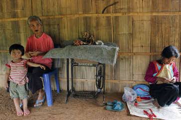 """70-year old ethnic """"Lahu"""" woman, Asami, stays at home with her granddaughter in Mae Chan District, Chiang Rai province"""
