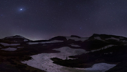 stars over snowy hills