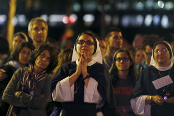 A nun watches Pope Francis' speech on a screen during the Festival of Families rally along Benjamin Franklin Parkway in Philadelphia, Pennsylvania
