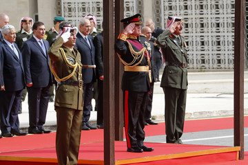 Jordan's King Abdullah reviews the honour guard before the opening of the second ordinary session of 17th Session of Parliament in Amman