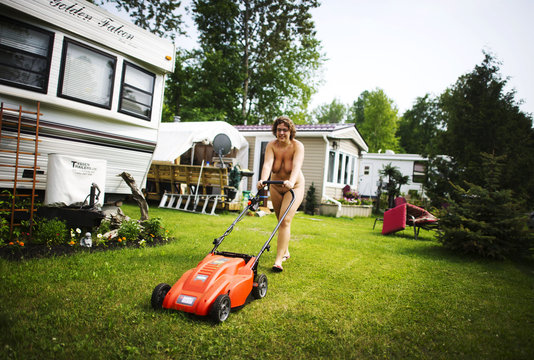 A woman mows her lawn at the Bare Oaks Family Naturist park in Sharon