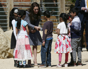Britain's Catherine, Duchess of Cambridge visits the Magic Garden at Hampton Court Palace near London