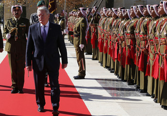 German President Gauck reviews Bedouin honour guards during his visit to Jordan at the Royal Palace in Amman