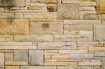 Wall made of sandstone blocks and smaller pieces