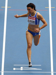 Belimpasaki of Greece crosses the finish line in her women's 200 metres heat during the IAAF World Athletics Championships in Moscow
