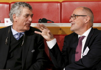 Gillieron Chairman of Swiss Football Association gestures next to UEFA Vice-President Villar Llona of Spain before the draw of Europa League semi finals in Nyon