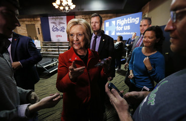 Democratic U.S. presidential candidate Clinton talks with Iowa supporters at her campaign event in Carroll, Iowa