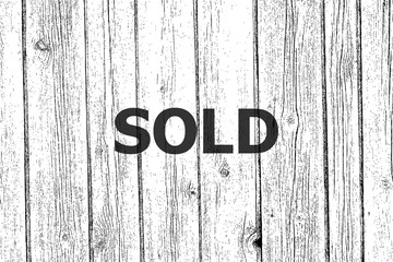 Text Sold. Business concept . Wooden texture background. Black and white