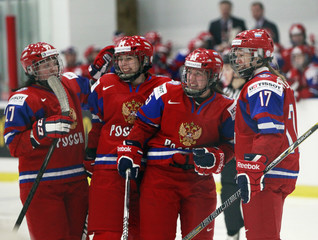 Russia's Skiba celebrates her goal with teammates Dyubanok, Tkachyova, and Smolentseva during the second period of their preliminary round game against Sweden at the IIHF Ice Hockey Women's World Championship in Ottawa