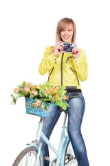 Woman on bicycle with vintage film camera