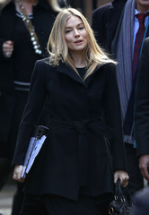 Sienna Miller arrives at the Leveson Inquiry into media practices at the High Court in central London