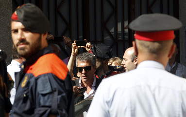 Jorge Horacio Messi, father of Barcelona's soccer player Lionel Messi, leaves after answering charges of tax evasion in the court in Gava