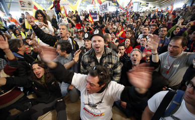 Iberia employees stage a sit-in protest as they shout slogans in Terminal 4 of Barajas airport during an Iberia strike in Madrid