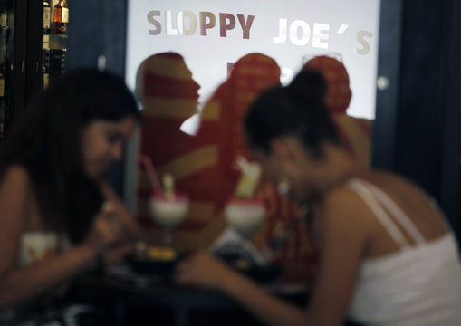 People sit in the newly opened Sloppy Joe's bar in Havana