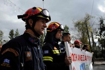 Firemen take part in an anti-austerity rally in Athens